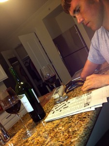 Relaxing with a glass of wine and a crossword puzzle